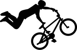 Silhouette of bmx rider stunt Stock Photography