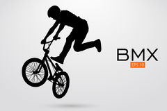 Silhouette of a BMX rider. Vector illustration. Silhouette of a BMX rider. Background and text on a separate layer, color can be changed in one click. Vector Royalty Free Stock Photo