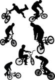 Silhouette of bmx riders. On a white background. Vector illustration Stock Photo