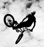 Silhouette of bmx riders in action Stock Photography