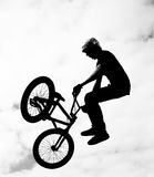 Silhouette of bmx riders in action Stock Images