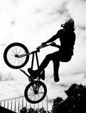 Silhouette of bmx riders in action Stock Image