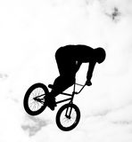 Silhouette of bmx riders in action Stock Photo