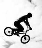 Silhouette of bmx riders in action Royalty Free Stock Photo