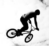 Silhouette of bmx riders in action Royalty Free Stock Image