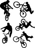 Silhouette of bmx riders on a white background. Royalty Free Stock Photos