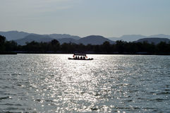 Silhouette of a boat. In sunset Royalty Free Stock Image