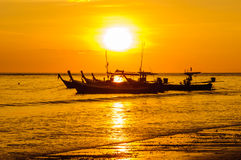 Silhouette boat at beach and sunset Royalty Free Stock Photo