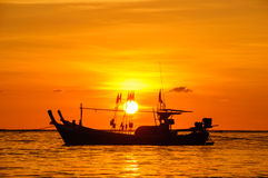 Silhouette boat at beach and sunset Royalty Free Stock Image
