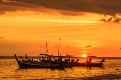 Silhouette boat at beach and sunset Stock Image