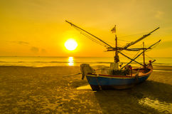 Silhouette. Boat on the beach in the twilight time Stock Photography