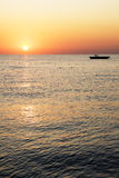 Silhouette boat with beautiful sunrise Stock Photos