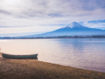 Silhouette boat on ground at side of lake kawaguchi on morning t Royalty Free Stock Images