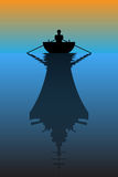 Silhouette of a boat and his reflection as a warship Royalty Free Stock Photo