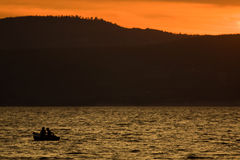 Silhouette Of Boat On The Lake stock photos