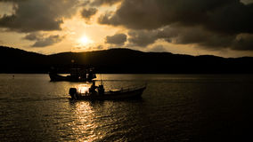 Silhouette a boat on the lake royalty free stock photo