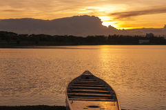 Silhouette of  boat on lake at sunset Royalty Free Stock Photo