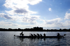 Silhouette boat racing Stock Images