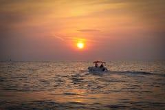 Silhouette Boat in the sea Stock Photo
