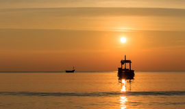 Silhouette boat on the sea with sunset Royalty Free Stock Image