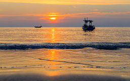 Silhouette boat on the sea with sunset Stock Image