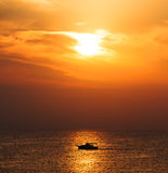 Silhouette Boat on sunrise Stock Image