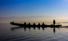 Silhouette of boat at sunset Inle Lake Burma Myanmar Stock Photos