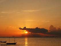 Silhouette boat on the sunset sea Royalty Free Stock Image