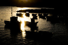 Silhouette Boats at Sunset Royalty Free Stock Photography