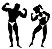 Silhouette of Body Builders Royalty Free Stock Photography