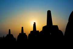 Silhouette Borobudur Temple, Yogyakarta, Java, Indonesia. Silhouette Borobudur Temple at sunrise time with light burst, Yogyakarta Stock Images