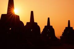 Silhouette Borobudur Temple, Yogyakarta, Java, Indonesia. Silhouette Borobudur Temple at sunrise time with light burst, Yogyakarta Stock Photo