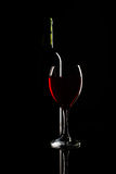 Silhouette of bottle and glass of wine over black Stock Photography