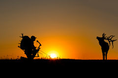 Silhouette of a bow hunter Stock Photo