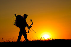 Silhouette of a bow hunter Stock Image