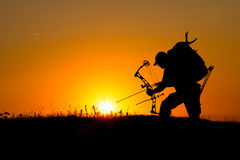 Silhouette of a bow hunter Stock Photography