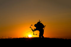 Silhouette of a bow hunter Stock Photos