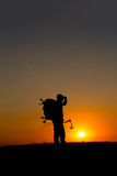 Silhouette of a bow hunter Royalty Free Stock Photo