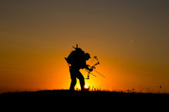 Silhouette of a bow hunter Stock Images