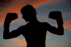 Silhouette boxer flexing Stock Photography