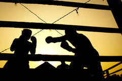 Silhouette boxing fight. Silhouette outdoor boxing fight in Thailand Stock Images
