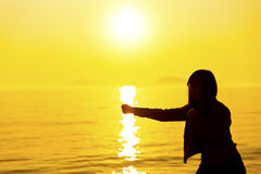 Silhouette of the boxing girl exercising at sunset Stock Images
