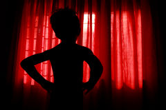 Silhouette of a boy Stock Photos