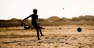 Silhouette of  boy on the beach Stock Photography