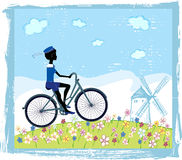 Silhouette of boy on bike. Riding on the field of flowers Royalty Free Stock Photography