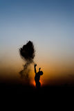 Silhouette of a boy. Silhouette of a boys playing sand on sunset Royalty Free Stock Photos