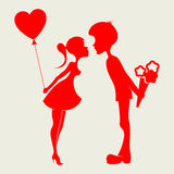 Silhouette of a boy and girl. Romantic silhouettes of couples with flowers and balloon in hand Royalty Free Stock Images