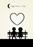 Silhouette of boy and girl sitting on a bench,  Royalty Free Stock Photos