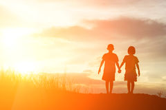 Silhouette boy and girl at sunset, romantic scene and love conce Royalty Free Stock Photography