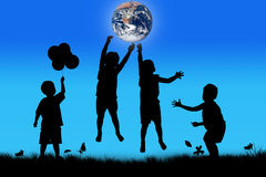 Silhouette of boy happy jumping touch the earth Royalty Free Stock Images
